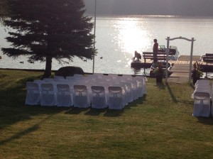 chairs set up by waterfront with sun shining